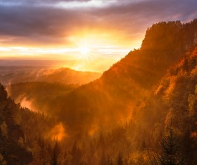 Sun beam on beautiful forest mountain scene Stock Photo
