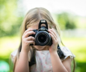 Take pictures of the little girl Stock Photo