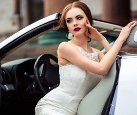 The beautiful bride sitting in a wedding car Stock Photo 01