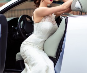 The beautiful bride sitting in a wedding car Stock Photo 02