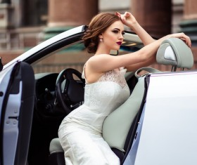 The beautiful bride sitting in a wedding car Stock Photo 03