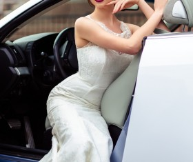 The beautiful bride sitting in a wedding car Stock Photo 04
