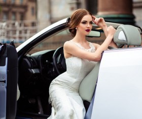 The beautiful bride sitting in a wedding car Stock Photo 05