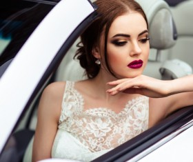 The beautiful bride sitting in a wedding car Stock Photo 06