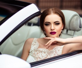 The beautiful bride sitting in a wedding car Stock Photo 07
