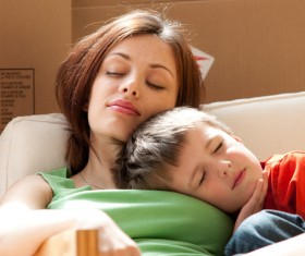 The little boy who slept with her mother Stock Photo