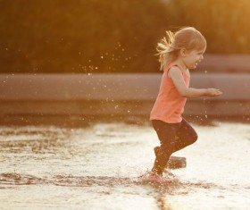 The little girl running in the water Stock Photo