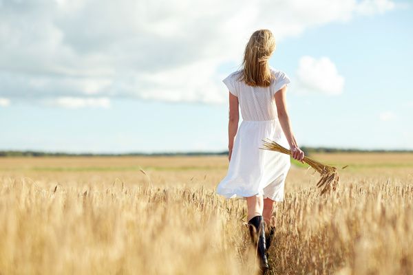 The woman holding the wheat back shadow Stock Photo