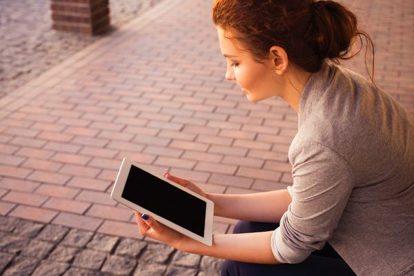 The woman looked at Apple Tablet iPad Stock Photo