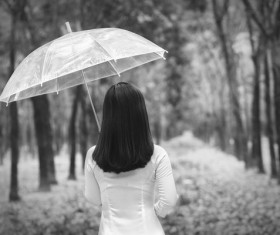 The woman with an umbrella back shadow Stock Photo