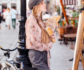 The young girl holding the bread on the street Stock Photo 09