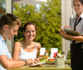 Tourists at outdoor cafes meal Stock Photo