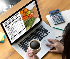 Use the computer to check your health diet recipes Stock Photo
