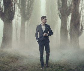 Walking handsome man in thick fog Stock Photo 02