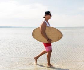 Walking on the beach man Stock Photo