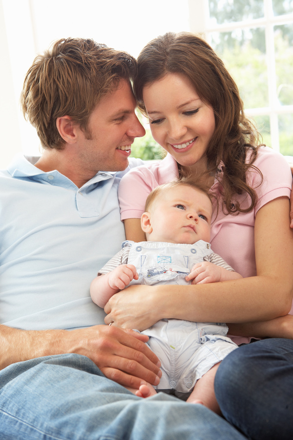 Watching young parents of newborn babies Stock Photo 02