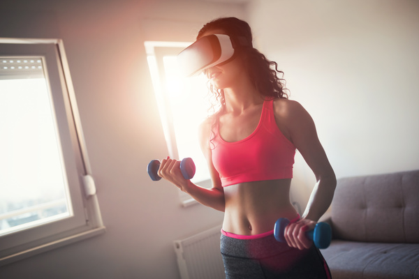 With VR glasses fitness woman Stock Photo