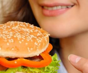Woman eating hamburger Stock Photo 01