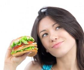 Woman eating hamburger Stock Photo 02