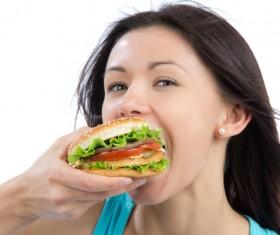 Woman eating hamburger Stock Photo 03