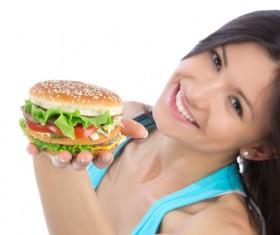 Woman eating hamburger Stock Photo 05