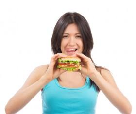 Woman eating hamburger Stock Photo 06