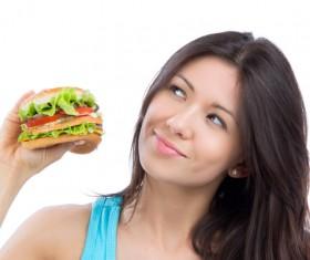 Woman eating hamburger Stock Photo 07