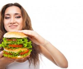 Woman eating hamburger Stock Photo 11