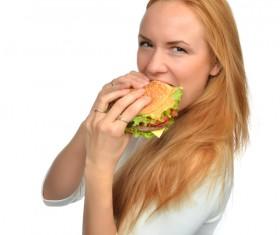 Woman eating hamburger Stock Photo 15