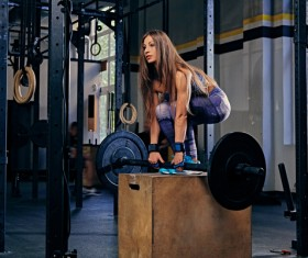 Woman in the gym lifting barbell Stock Photo 14