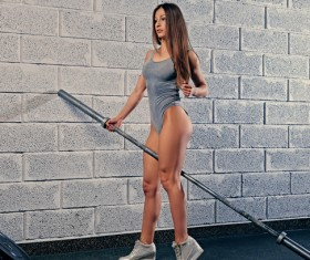 Woman in the gym lifting barbell Stock Photo 15