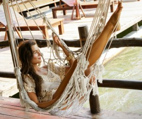 Young girl sitting on a hammock Stock Photo 03