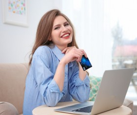 Young woman shopping online at home Stock Photo 03
