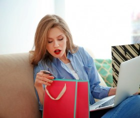 Young woman shopping online at home Stock Photo 06