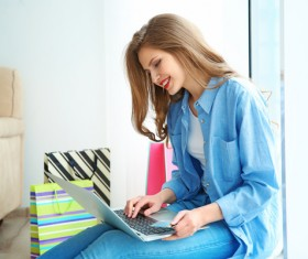 Young woman shopping online at home Stock Photo 10