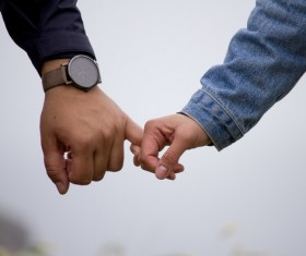 closeup romantic lovers hand hand Stock Photo