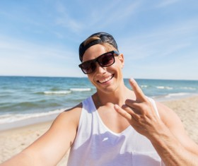 man smiling at the beach Stock Photo