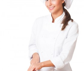 woman chef who cuts tomatoes Stock Photo
