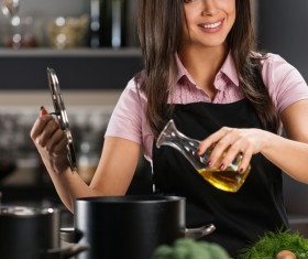 young woman who cooks in the kitchen Stock Photo 02