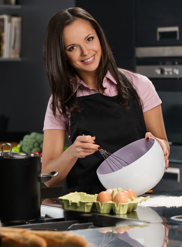 young woman who cooks in the kitchen Stock Photo 03