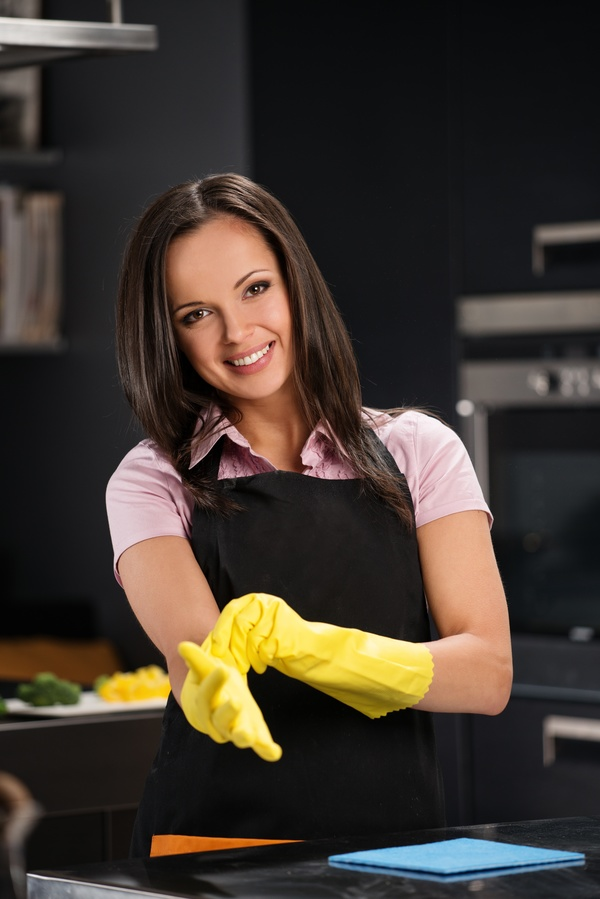 young woman who cooks in the kitchen Stock Photo 07