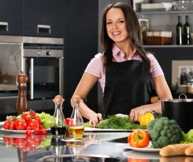 young woman who cooks in the kitchen Stock Photo 08