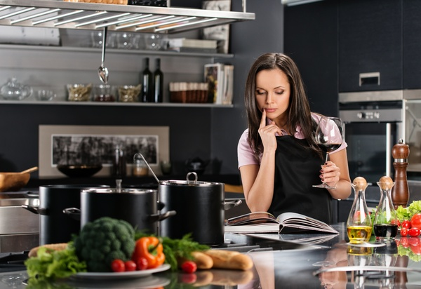 young woman who cooks in the kitchen Stock Photo 09