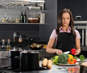 young woman who cooks in the kitchen Stock Photo 11