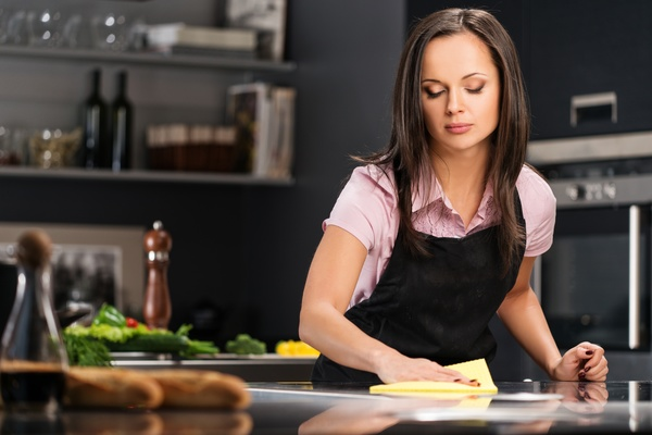 young woman who cooks in the kitchen Stock Photo 12
