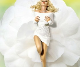 A woman lying on a white flower Stock Photo