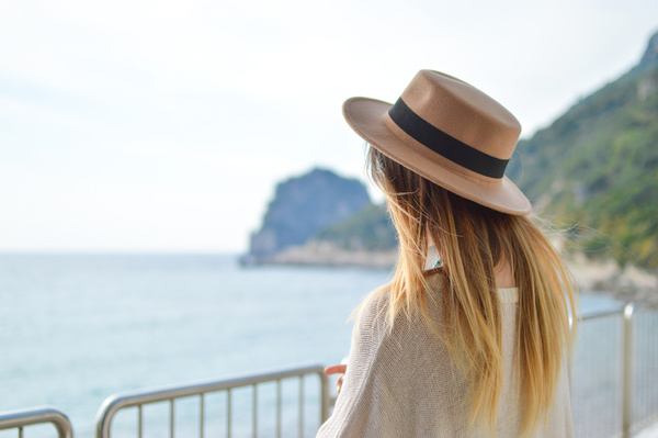 Beautiful blonde girl posing with hat Stock Photo