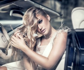 Blond girl with luxury cars Stock Photo 03