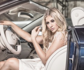Blond girl with luxury cars Stock Photo 04