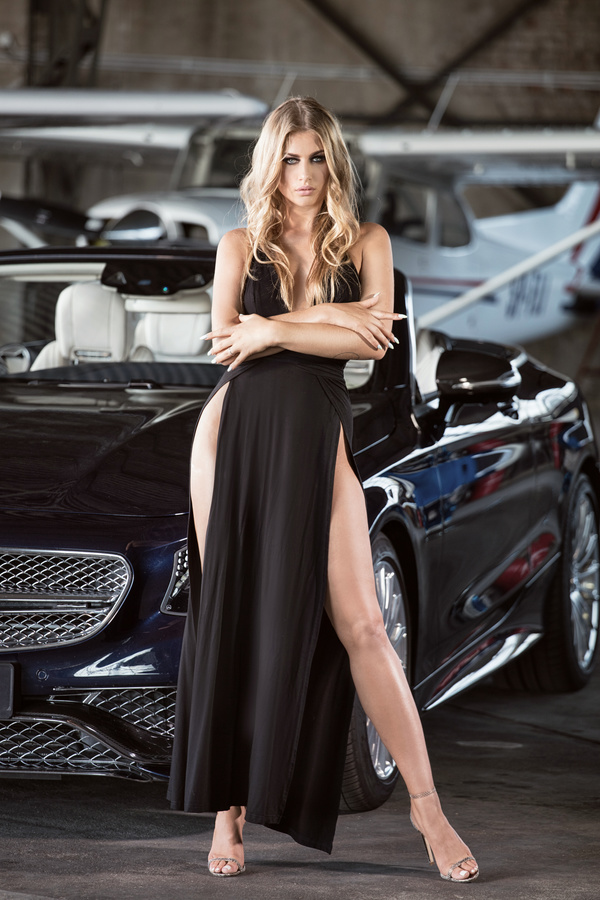 With nude girl with sports car was under